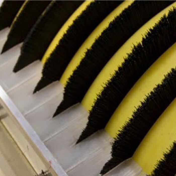 Brush drum skimmer for oil spill response